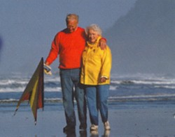 Photo of couple strolling on the beach
