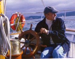 Photo of man on sailboat